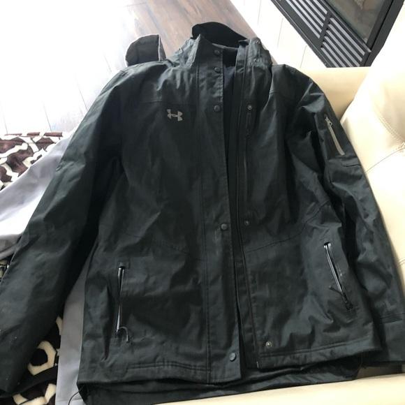Black under armor rain coat with pants.